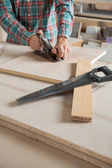 Midsection Of Carpenter Using Planer At Workbench — Stock Photo