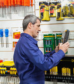Worker Looking At Packed Product In Hardware Store — Stock Photo