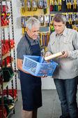 Salesman Assisting Male Customer In Buying Product — Foto de Stock