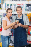 Customer And Salesman Holding Flashlight In Store — Stock Photo