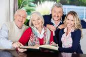 Happy Family With Book In Nursing Home — Stock Photo