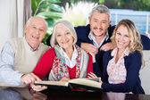 Happy Family With Book In Nursing Home — Foto Stock