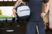 Fit Man Carrying Medicine Ball — Stock Photo