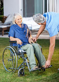 Nurse Adjusting Footrest For Senior Woman On Wheelchair — Stock Photo