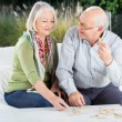 Happy Senior Couple Playing Dominoes At Porch — Stock Photo #57260323