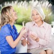 Cheerful Granddaughter Showing Playing Cards To Grandmother — Stock Photo #57264273