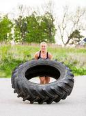 Athlete Doing Tire-Flip Exercise On Street — Stock Photo