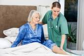 Caretaker Examining Senior Womans Leg — Stock Photo