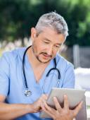 Male Caretaker Using Tablet PC — Stock Photo