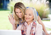 Happy Senior Woman And Granddaughter Video Chatting On Laptop — Stock Photo
