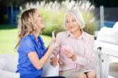 Cheerful Granddaughter Showing Playing Cards To Grandmother — Stock Photo