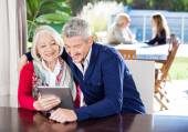 Grandmother And Grandson Using Digital Tablet At Nursing Home — Stock Photo