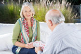 Happy Senior Woman Playing Cards With Man — Stock Photo