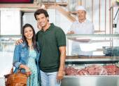 Happy Couple Standing In Butchery — Stock Photo