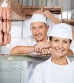 Happy Male Butcher With Colleague At Butchery — Stock Photo