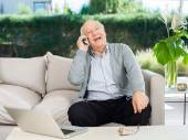 Cheerful Senior Man Answering Smartphone At Porch — Stock Photo