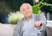 Portrait Of Senior Man Holding Metal Cane — Stock Photo