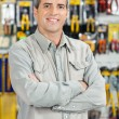 Happy Man Standing Arms Crossed In Hardware Store — Stock Photo #57445889