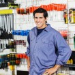 Customer With Hands On Hip Smiling In Hardware Shop — Stock Photo #57446975