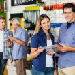 Happy Couple Holding Tool Set In Hardware Store — Stock Photo #57448141