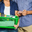 Couple Carrying Basket Full Of Tools In Store — Stock Photo #57448609