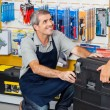 Salesman With Tool Box In Store — Stock Photo #57448789