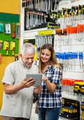 Family Using Tablet Computer In Hardware Store — Stock Photo