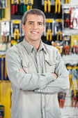 Happy Man Standing Arms Crossed In Hardware Store — Stock Photo
