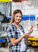 Customer Holding Mobilephone And Screwdriver In Store — Stock Photo