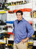 Customer With Hands On Hip Smiling In Hardware Shop — Stock Photo