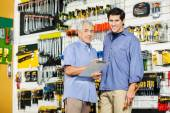 Father And Son With Clipboard In Hardware Store — Stock Photo