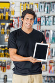 Smiling Man Presenting Digital Tablet In Hardware Store — Stock Photo