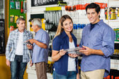 Happy Couple Holding Tool Set In Hardware Store — Stock Photo