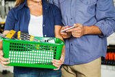 Couple Carrying Basket Full Of Tools In Store — Foto de Stock