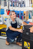 Salesman With Tool Box In Store — Stock Photo
