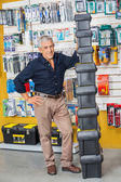 Senior Man Standing By Stacked Toolboxes In Shop — Stock Photo