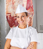 Confident Butcher With Arms Crossed In Butchery — Stock Photo