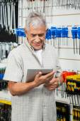 Customer Using Digital Tablet In Hardware Shop — Stock fotografie