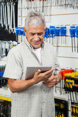 Customer Using Digital Tablet In Hardware Shop — Stock Photo