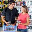 Couple Paying Through Credit Card In Hardware Store — Stock Photo #57459043