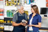 Salesman Holding Electronic Reader While Customer Paying Through — Stockfoto