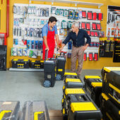 Salesman Showing Tool Cases To Customer In Store — Stockfoto