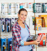 Customer Holding Packed Product In Hardware Store — Stock Photo