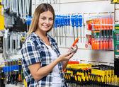Customer Holding Cellphone And Screwdriver In Store — Fotografia Stock