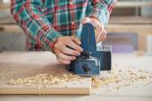 Carpenter Working With Electric Planer On Wood — Stock Photo