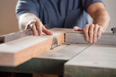 Midsection Of Carpenter Cutting Wood With Tablesaw — Stock Photo