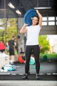 Fit Woman Lifting Barbell Plate — Stock Photo