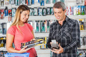 Couple Paying For Flashlight Through Smartphone In Store — Stockfoto