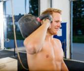 Man Exercising With Kettlebell In Gym — Stock Photo