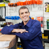 Worker Leaning On Tool Package In Hardware Shop — Stock Photo